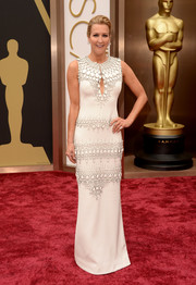 Lara Spencer wore an embellished white gown with a keyhole cutout to the 2014 Academy Awards.
