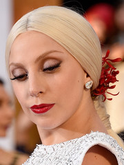 Lady Gaga attended the Oscars sporting shimmery silver lids and a sexy red lip.