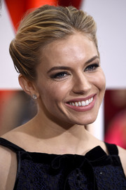 Sienna Miller paired her 'do with simple yet elegant diamond studs.