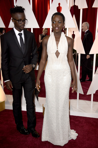 More Pics of Lupita Nyong'o Short Curls (1 of 52) - Short Hairstyles Lookbook - StyleBistro [red carpet,carpet,dress,formal wear,gown,suit,event,flooring,fashion,tuxedo,hollywood highland center,california,87th annual academy awards,arrivals,lupita nyongo,peter nyongo]