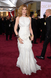 Rene Russo looked flirty and feminine at the Oscars in a white J. Mendel gown rendered in chevron-patterned layers.