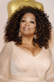 Oprah Winfrey went to the Oscars wearing her hair in a big shock of curls.