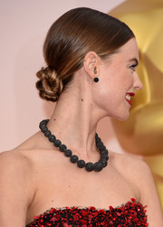 Behati Prinsloo wore her tresses in a sleek, twisted bun when she attended the Oscars.