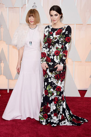 Bee Shaffer oozed feminine appeal in a long-sleeve rose-print gown during the Oscars.