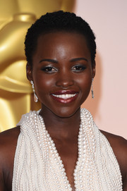 Lupita Nyong'o finished off her look with shimmery silver eyeshadow.