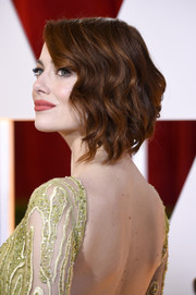Emma Stone attended the Oscars wearing the most perfectly sweet waves.