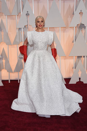 Lady Gaga attended the Oscars looking like an elaborately clothed doll in a white Alaia gown that was fully beaded in a web-like pattern.