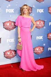Sheryl Crow charmed in an asymmetrical pink gown by Juan Carlos Obando at the American Country Awards.
