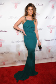 Angela Martini showed off her model figure at the Angel Ball in a slinky teal evening dress with embellished shoulder straps.