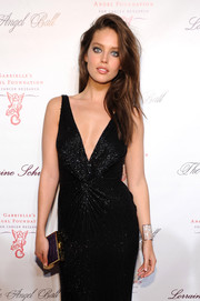Emily DiDonato complemented her gown with an elegant purple and gold box clutch when she attended the Angel Ball.