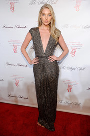 Elsa Hosk went for sexy glamour at the Angel Ball in a sparkly gray gown with a navel-grazing neckline.