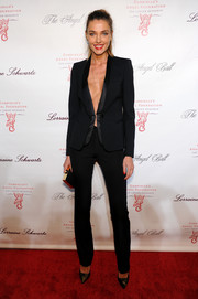 Fashion model Alina Baikova wore a revealing tuxedo-inspired suit to the Angel Ball.