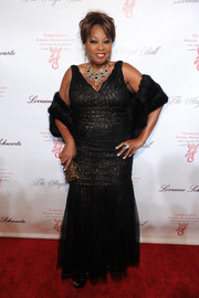 Star Jones was all glammed up in a black lace mermaid gown and a fur stole during the Angel Ball.