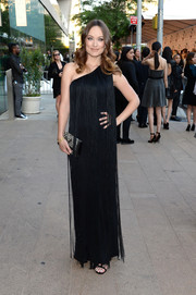 Olivia Wilde styled her black dress with a chic geometric-beaded clutch.