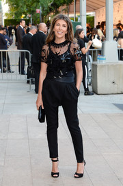 Nina Garcia added a funky touch to her look with a pair of black harem pants.
