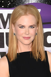 Nicole Kidman's signature sleek strawberry tresses elongated her face when styled into a straight 'do.