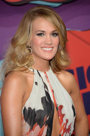 Carrie Underwood attended the CMT Music Awards looking fab with her high-volume curls.