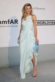 Jessica Hart polished off her look with a pastel-blue box clutch.