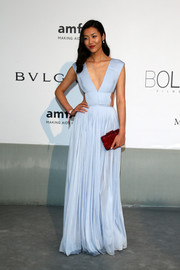 After that fabulous Met Gala gown, Liu Wen continued to stun in a goddess-worthy pastel-blue Vionnet cutout dress at the Cinema Against AIDS Gala.