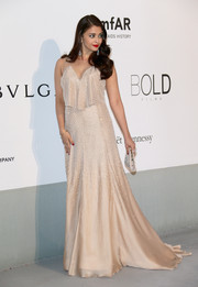 Aishwarya Rai went for sparkly sophistication in a crystal-studded Armani Prive gown at the Cinema Against AIDS Gala.