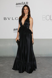 Julia Restoin-Roitfeld cut an ultra-feminine silhouette in a black Givenchy gown with a plunging neckline and a peplum waist during the Cinema Against AIDS Gala.