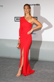 Bar Refaeli paired her elegant dress with simple nude ankle-strap sandals.