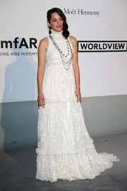 Marion Cotillard was classic and feminine in a high-neck white Alexander McQueen gown during the Cinema Against AIDS Gala.