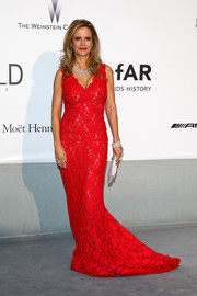 Kelly Preston was a style standout in a red lace gown by Oliver Tolentino Couture during the Cinema Against AIDS Gala.