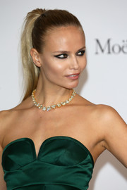 Natasha Poly balanced out her edgy beauty look with a glamorous diamond necklace.