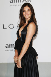 Julia Restoin-Roitfeld paired gold bangle bracelets with a plunging black gown for the Cinema Against AIDS Gala.