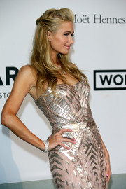 Paris Hilton attended the Cinema Against AIDS Gala wearing an ultra-luxe diamond-studded watch.