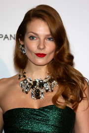 Eniko Mihalik topped off her look with an attention-grabbing gemstone statement necklace and matching earrings.