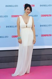 Cristina Brondo rocked a cream-colored sleeveless gown that featured a sheer flowing skirt.