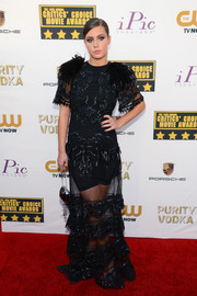 Adele Exarchopoulos went all out with the frills in a sheer black feather-and-lace dress by Louis Vuitton during the Critics' Choice Awards.