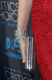Emily Blunt chose a cute silver box clutch to match her other silver accessories.
