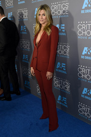 Jennifer Aniston looked gorgeous in a burnt orange suit with a low cut jacket at the Critics' Choice Movie Awards.