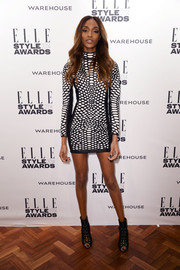 Jourdan Dunn teamed her leather dress with edgy-chic black booties for a totally cool look.