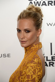 Poppy Delevingne showed off a more elegant version of the top knot during the Elle Style Awards.