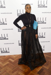 Laura Mvula finished off her look in dramatic style with a floor-grazing sheer black skirt.
