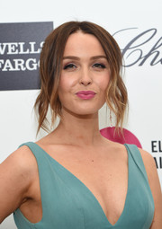 Camilla Luddington went for an edgy center-parted updo when she attended Elton John's Oscar-viewing party.