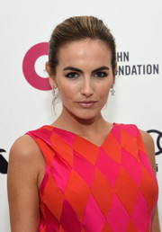 Camilla Belle kept it classic with this elegant bun during Elton John's Oscar-viewing party.