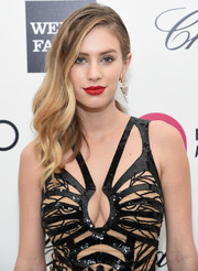 For Elton John's Oscar-viewing party, Dylan Penn styled her hair with gentle waves swept to the side.