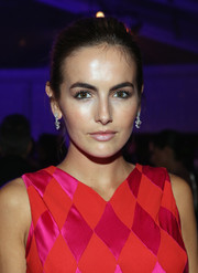 Camilla Belle attended the Elton John AIDS Foundation Oscar-viewing party wearing a pair of dangling diamond earrings by Chopard.