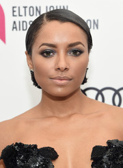 Kat Graham attended Elton John's Oscar-viewing party wearing a slicked-down bob.