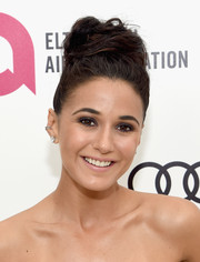 Emmanuelle Chriqui swept her locks up into a voluminous top knot for Elton John's Oscar-viewing party.