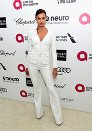 Irina Shayk covered up her curves in a white Versace Couture pantsuit for Elton John's Oscar-viewing party.