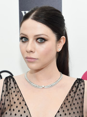 Michelle Trachtenberg opted for a simple center-parted pony when she attended Elton John's Oscar-viewing party.