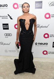 Kat Graham left us speechless with this cleavage-and-midriff-baring Michael Costello strapless gown she wore to Elton John's Oscar-viewing party.