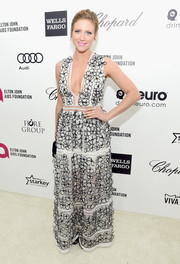 Brittany Snow totally charmed in a black-and-white floral-appliqued gown by Blumarine during Elton John's Oscar-viewing party.