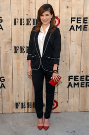 Sophia Bush attended the Feed USA + Target launch carrying an ultra-chic red YSL mail clutch.